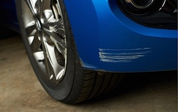 Dent or paint scratch repairs for vehicle fender or bumper