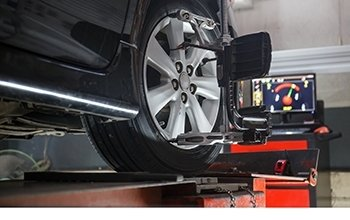 Wheel alignment and wheel rim repair services